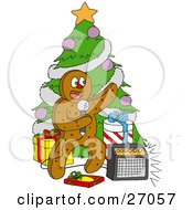 Clipart Illustration Of A Festive Gingerbread Man Standing In Front Of A Christmas Tree With Gifts Singing Karaoke by LaffToon