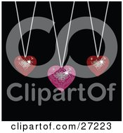 Clipart Illustration Of Two Sparkling Red And One Pink Disco Like Heart Pendants Suspended From Silver Necklaces Over A Black Background