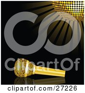 Gold Microphone Resting On A Reflective Black Surface Under A Glowing Golden Mirror Disco Ball