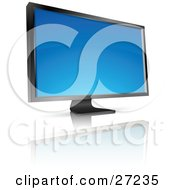 Black Flat Screen Computer Monitor Or Tv With A Blank Blue Screen Resting On A Reflective White Surface