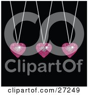Clipart Illustration Of Three Sparkling Pink Disco Like Heart Pendants Suspended From Silver Necklaces Over A Black Background by elaineitalia