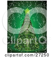 Green Mirrored Disco Tree Topped With A Star On A Green Background With Snow