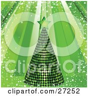 Green Mirrored Disco Tree Topped With A Star On A Green Background Rays Of Light Snow And Stars
