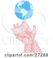 Human Hands Reaching Up Towards Or Releasing The Blue Planet Earth Over A White Background