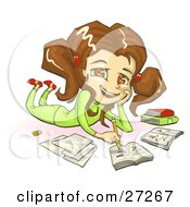 Smiling Brunette Brown Eyed School Girl In Green Clothes Laying On Her Belly And Doing Homework For School
