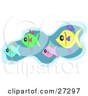 Clipart Illustration Of A Schooling Group Of Blue Green Pink And Yellow Fish Swimming