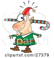 Clipart Illustration Of A Confused Elf Walking Around With A Colorful Striped Candy Cane Going Through One Ear And Out The Other by Ron Leishman