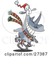Clipart Illustration Of A Festive Christmas Rhino Riding A Unicycle And Wearing A Santa Hat And Green White And Red Scarf