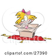 Hyper Little Blond Caucasian Girl Inside An Open Box With Opened Wrapping Paper Underneath