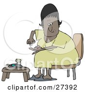 Clipart Illustration Of A Diabetic Black Woman Sitting In A Chair At A Table And Pricking Her Finger With A Lancing Device For A Blood Sample