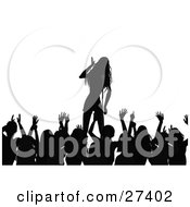 Clipart Illustration Of A Silhouetted Crowd Of Fans Waving Their Arms While Listening To A Female Singer On Stage During A Music Concert