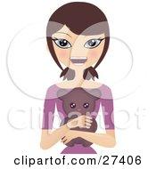 Smiling Caucasian Brunette Woman In A Purple Shirt Hugging A Cute Teddy Bear