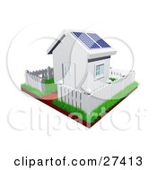 Cute Little White House With Green Grass A Picket Fence And Solar Panels On The Roof