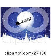 Santa His Sleigh And Reindeer Silhouetted As They Pass In Front Of The Full Moon On A Blue Snowy Wintry Night