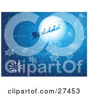 Clipart Illustration Of Flying Reindeer Transporting Santa On A Snowing Blue Winter Night With A Full Moon And Large Snowflakes