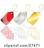 Collection Of Three Red Silver And Gold Christmas Gift Tags With Stars On A Reflective White Surface