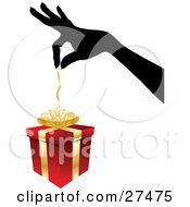 Clipart Illustration Of A Silhouetted Womans Hand Pulling The Ribbon Of Of A Red And Gold Christmas Present by KJ Pargeter
