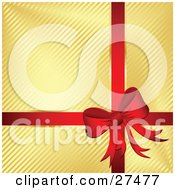 Clipart Illustration Of A Red Bow And Ribbon Adorning A Gift Wrapped In Golden Striped Paper