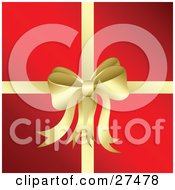 Clipart Illustration Of A Golden Bow And Ribbon Adorning A Christmas Present Wrapped In Red Paper by KJ Pargeter