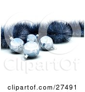 Clipart Illustration Of Four Blue Snowflake Baubles And Tinsel