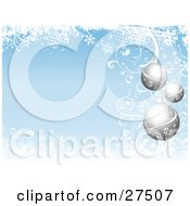 Clipart Illustration Of Three Silver Floral Ornaments Suspended Over A Pale Blue Background Bordered With Snowflakes