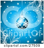 Blue Christmas Ornament With White Snowflake Patterns Suspended Over A Bursting Blue Background With Grasses And Stars by KJ Pargeter