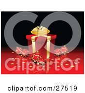 Clipart Illustration Of A Red Snowflake And Star Patterned Ornaments And Golden Confetti Surrounding A Gold And Red Christmas Present On A Reflective Surface And A Black Background