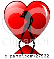 Clipart Illustration Of A Sexy Silhouetted Woman Standing On A Reflective Surface In Front Of A Big Red Heart
