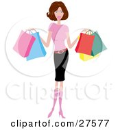 Smiling Slender Caucasian Woman In Pink Boots A Pink Shirt And Pencil Skirt Holding Colorful Shopping Bags