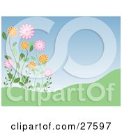 Clipart Illustration Of Pink And Orange Wildflowers Growing On A Green Hill Against A Blue Sky