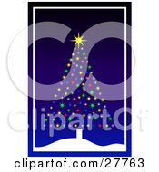 Bright Christmas Tree Made Of Colorful Bursts Of Light And A Shining Star On A Snowy Hill Over A Blue Background