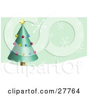 Green Christmas Tree Decorated In Yellow Red And Blue Ornaments With A Yellow Star In A Snowy Landscape With Big Snowflakes Falling From A Green Sky