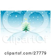 Clipart Illustration Of Snow Falling Over A Hilly Landscape With An Evergreen Christmas Tree Topped With A Yellow Star And A Blue Sky