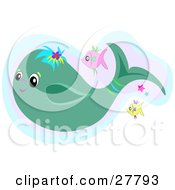 Clipart Illustration Of Pink And Yellow Fish Swimming With A Blue Whale
