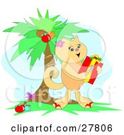 Clipart Illustration Of A Cute Kitty Cat Holding A Candy Cane And Christmas Gift Under A Palm Tree by bpearth