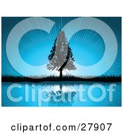 Clipart Illustration Of A Black Silhouetted Triangle Shaped Tree And Grasses Reflecting In Calm Blue Waters Over A Bursting Sky Background