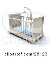 White Boys Baby Crib In A Nursery With A Blue Pad And Teddy Bear Mobile