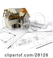 Clipart Illustration Of A Nearly Completed Home Resting On Floor Plans Beside A Laptop Computer