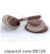 Clipart Illustration Of A Wooden Judge Or Auctioneer Gavel Resting On A White Surface