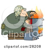 Homeless Caucasian Man Eating Beans Out Of The Can While Sitting Beside A Fire In A Trash Can