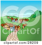 Cobblestone Road Leading To A Village Of Homes And Buildings In A Hilly Landscape