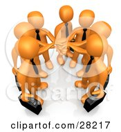 Group Of Seven Orange Businessmen Carrying Briefcases And Standing With Their Hands Together Symbolizing Teamwork Cooperation Support Unity And Goals