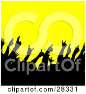 Clipart Illustration Of A Black Silhouetted Crowd Waving Their Hands In The Air At A Concert Over Yellow