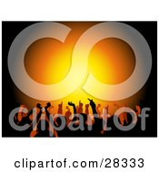 Clipart Illustration Of A Silhouetted Crowd Holding Their Arms Up Over A Background With Gradient Orange And Yellow Light