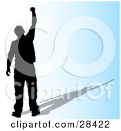 Clipart Illustration Of A Black Silhouetted Successful Man Holding His Fist Up In The Air Over A Gradient Blue Background by KJ Pargeter