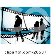 Clipart Illustration Of Three Black Silhouetted People Standing On A Giant Film Strip Over A Blue Background