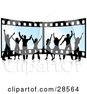 Clipart Illustration Of A Happy Group Of Eight Black Silhouetted People Standing In Front Of A Giant Film Strip