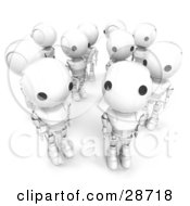 Group Of White AO Maru Robots Standing In A Crowd One Looking Up At The Viewer by Leo Blanchette