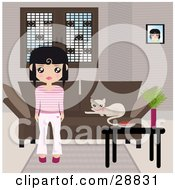 Black Haired Girl Dressed In Pink And White Standing In Front Of A Brown Couch With A Kitty Resting On The Cushions And A Table With A Bowl And Plant