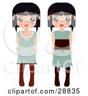 Two Black Haired Female Paper Dolls In Green Dresses And Black And Brown Tights